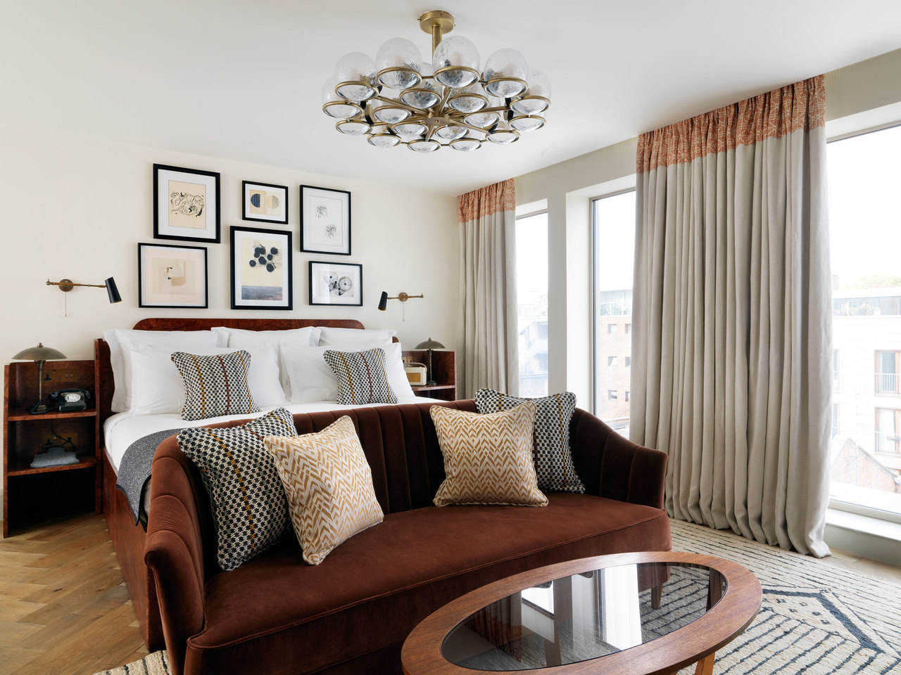 A bedroom with artwork and retro furnishings